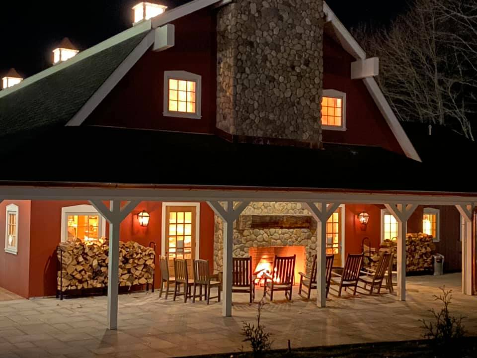 High Watch barn with evening fireplace outside